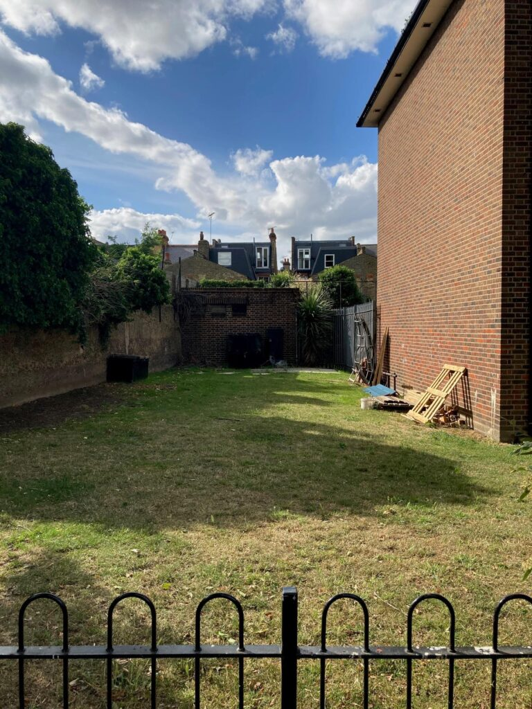 The plain grassed area behind Robert Owen House